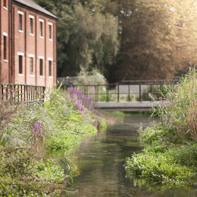 The-beautiful-River-Test-flowing-through-the-centre-of-the-Bombay-Sapphire-Distillery-at-Laverstoke-Mill