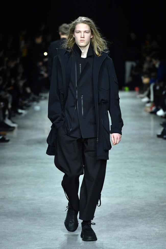 PARIS, FRANCE - JANUARY 22: A model walks the runway during the Y-3 Menswear Fall/Winter 2017 show at Palais De Tokyo on January 22, 2017 in Paris, France. (Photo by Pascal Le Segretain/Getty Images for Y-3)